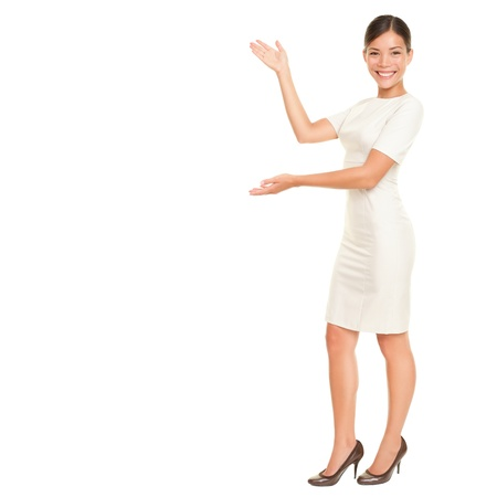welcoming: Full body woman showing and presenting copy space in business dress suit isolated on white background. Beautiful young mixed race chinese asian  white caucasian female businesswoman.