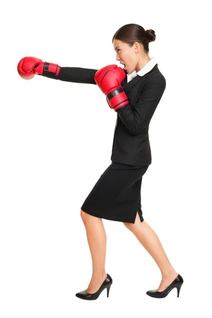 work glove: Business woman boxing - business competition concept with businesswoman punching and hitting standing in full length profile. Young Asian  Caucasian female professional isolated on white background.