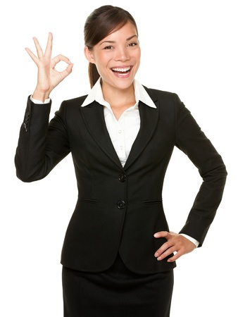 gestures: Perfect - business woman showing OK hand sign smiling happy. Young pretty Asian  Caucasian businesswoman isolated on white background.