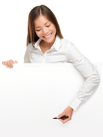 Woman writing on whiteboard sign from above. Woman holding pen smiling, drawing or writing with copy space for text. Beautiful mixed race Asian  Caucasian female businesswoman isolated on white background