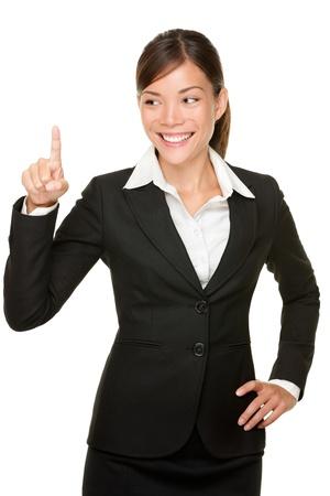 ビジネス女性のボタンを押すと。ボタンを押すと実業家か何か。あなたのデザインをコピー スペースで白い背景上に分離。 写真素材