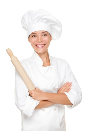 rolling: Baker  Chef woman smiling happy holding baking rolling pin wearing uniform isolated on white background. Beautiful young mixed race Asian Caucasian female model with arms crossed standing proud and confident. Stock Photo