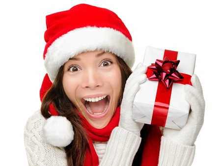 Christmas gift woman isolated. Happy excited santa woman showing christmas prensent isolated on white background. Stock Photo - 10704093