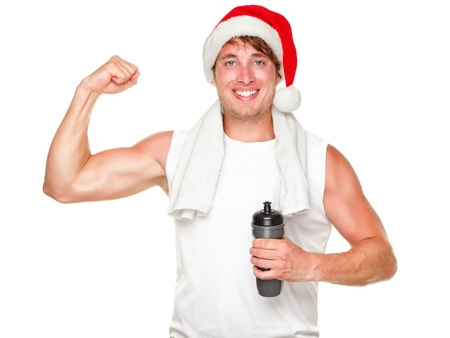 Christmas fitness man showing bicep muscles fit for holidays. Handsome male in his 20s wearing santa hat isolated on white background. Stock Photo - 10704090