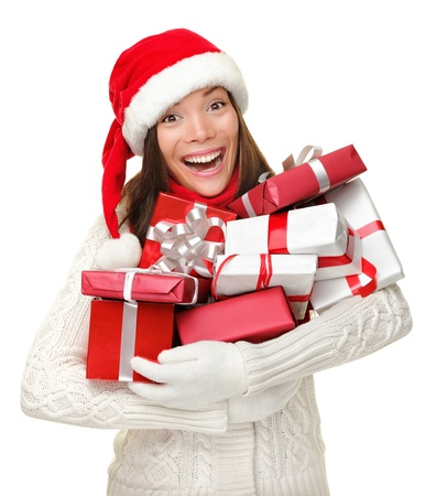 holiday spending: Santa hat Christmas woman holding christmas gifts smiling happy and excited. Cute beautiful multi-racial Caucasian Asian santa girl isolated on white background.
