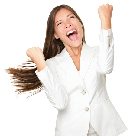 Happy winner - success business woman celebrating screaming and dancing of joy after winning something. Beautiful mixed race Chinese Asian  Caucasian businesswoman in white cheerful over her success. Isolated on white background.