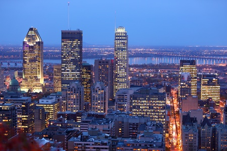 montreal: Montreal skyline by night. Dusk cityscape image of Montreal downtown, Quebec, Canada. Stock Photo
