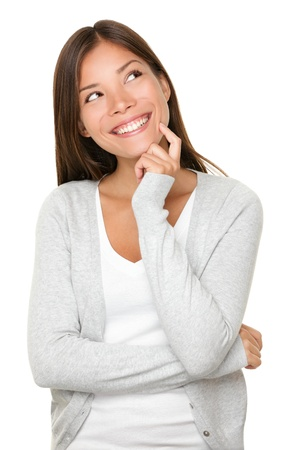 Asian woman thinking in looking pensive and happy in casual clothes isolated on white background.