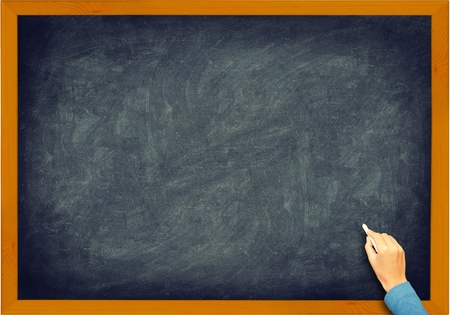 Blackboard closeup. Vintage retro chalkboard with hand, chalk and frame. Nice texture. Stock Photo - 10916753