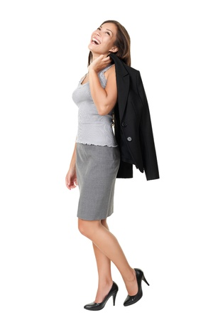 high heels: business woman laughing standing isolated on white background in full length. Beautiful joyful happy mixed race Chinese Asian  white Caucasian female model.