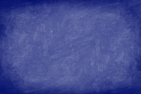 Chalkboard / dark blue blackboard texture background. Used feel, textured with chalk traces. Photo. Stock Photo - 11224450