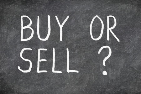 buy time: Buy or sell question on blackboard. Buying or selling question mark. Finance, economy, stock or real estate concept - time to buy or sell