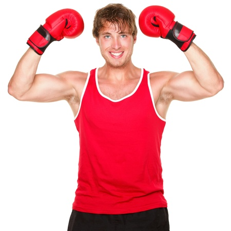 Fitness boxing man showing strength flexing muscles. Handsome strong fit boxer smiling happy wearing red boxing gloves isolated on white background. photo