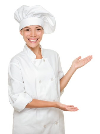 bakers: Cook or chef showing and presenting. Woman chef isolated on white background. Multicultural Caucasian Asian model. Stock Photo