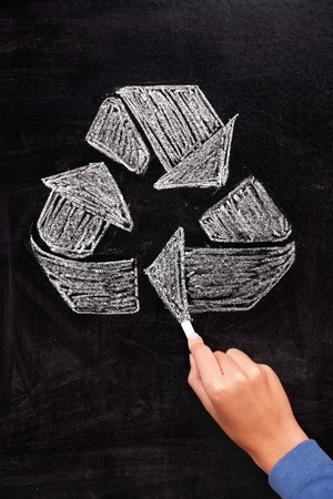 Recycling: Recycle sign on blackboard. Hand drawing recycle sign arrows on chalkboard. photo