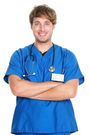 nurse uniform: Retrato de un m�dico. Enfermero o un m�dico joven, sonriendo feliz y orgulloso con una bata de color azul sobre fondo blanco. Joven hombre cauc�sico profesional de la medicina. Foto de archivo