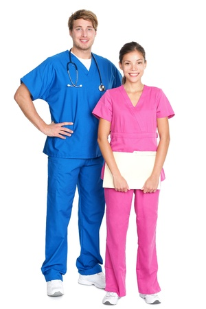 medical professionals standing isolated. Young caucasian man or young asian woman doctors or nurses in medical scrubs. photo