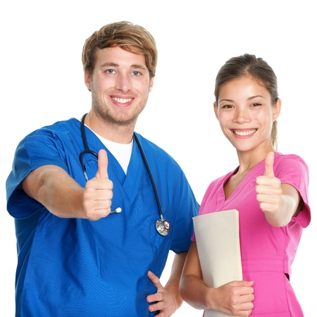 health professionals: Nurse and doctor team giving happy thumbs up smiling joyful at camera. Young medical professionals isolated on white background. Asian woman and Caucasian man in their 20s.