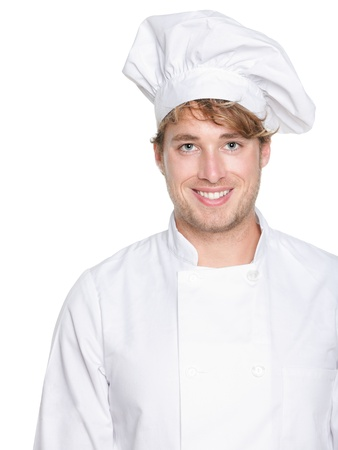 chefs whites: Chef, baker or male cook. Young man in chefs whites uniform smiling happy at camera. Portrait of young chef in his twenties. Stock Photo