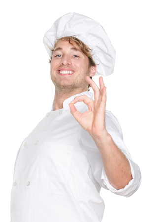 chefs whites: Chef. Chef, cook or baker showing hand sign for perfection and excellency smiling happy and proud looking at camera. Young caucasian male chef wearing chefs hat isolated on white background.