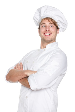 Chef man. Proud portrait of smiling happy cook, chef or baker wearing chefs hat. Cross-armed young Caucasian male model isolated on white background. photo