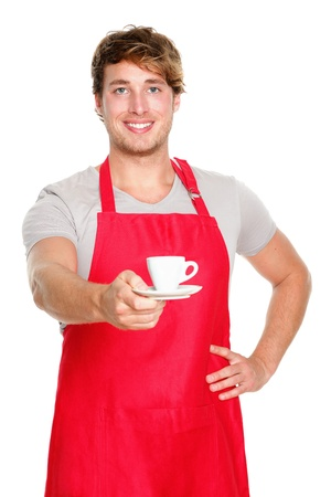 Barista  waiter man serving coffee wearing apron. Handsome young small coffee shop business owner isolated on white background. photo