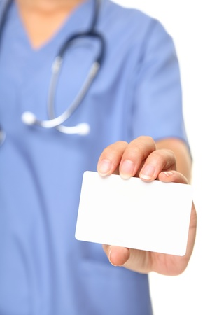 Nurse business card sign closeup. Female doctor or nurse holding and showing blank empty business card on white background. photo