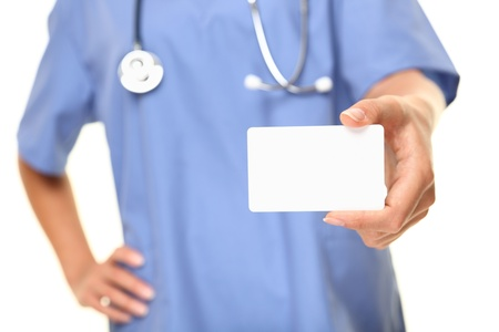 holding close: Doctor business card close up. Empty small sign card with copy space for text etc. Medical professional, doctor or nurse isolated on white background. Stock Photo