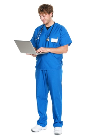 com: Male Nurse  doctor working on laptop pc computer smiling happy standing isolated in full length on white background. Young medical professional man.
