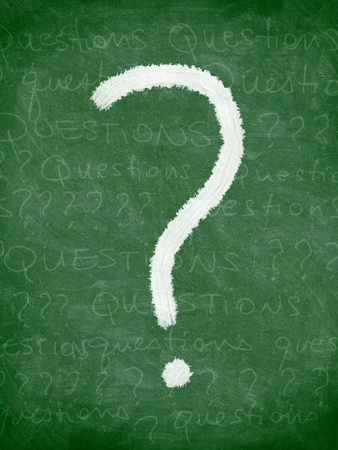 Question mark chalkboard  blackboard. Questions and question marks written half erased on green chalkboard texture. photo