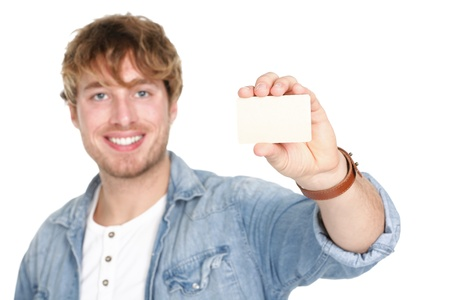 holding the head: Man showing business card sign. Young casual happy smiling man holding blank empty business card. Caucasian male model in his 20s.