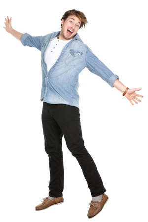 Man jumping excited in full body isolated on white background. Casual funny Caucasian guy in his twenties. photo