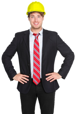 Engineer or architect man in suit wearing helmet isolated on white background. Young male professional smiling happy and confident Stock Photo - 12056441