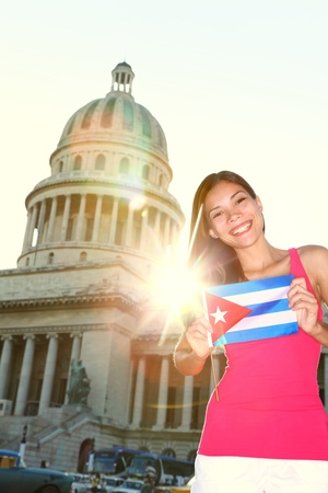 Havana, Cuba - Capitol and tourist with cuban flag in front of the National Capitol Building. Cuba travel concept photo with beautiful smiling happy woman tourist. Stock Photo - 12056439