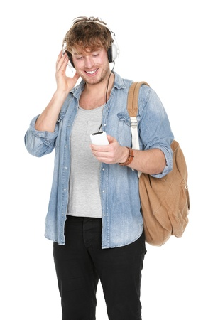 earphone: University student listening to music in headphones on smartphone. Young handsome male college student isolated on white background.