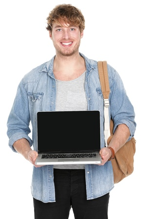 Male college  university student showing laptop screen smiling happy. Young caucasian man holding notebook computer pc showing empty blank screen with copy space. Young caucasian guy isolated on white background. photo