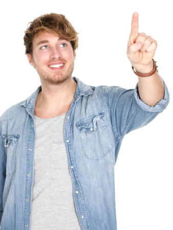 Young man pressing  pushing button isolated on white background. Young handsome smiling happy casual caucasian male in his 20s. photo