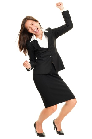 Celebrating business woman dancing happy and joyful cheering in suit isolated on white background in full body. Ecstatic and excited beautiful multiracial Caucasian  Chinese Asian young business woman. photo