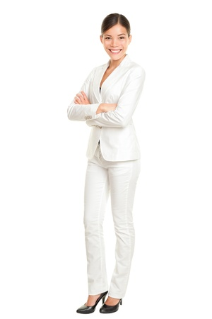 full suit: Asian business woman standing proud and confident in white suit isolated on white background in full body. Beautiful young mixed race Chinese Asian  Caucasian female businesswoman smiling happy. Stock Photo