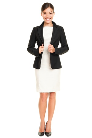 working attire: Ethnic Asian professional businesswoman standing confident in skirt suit isolated on white background.