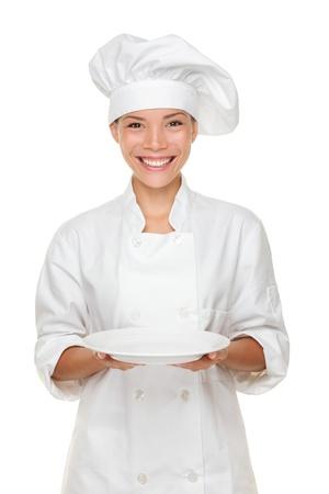 Chef-kok met lege plaat. Stockfoto