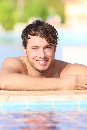 beach hunk: Man in swimming pool during vacation in holiday resort.