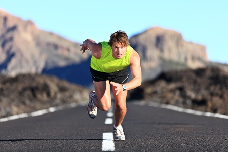 Sprinter. Man running on road at high speed in beautiful exotic mountain landscape. Male athlete runner in intense sprint during outdoor workout Stock Photo - 12288442