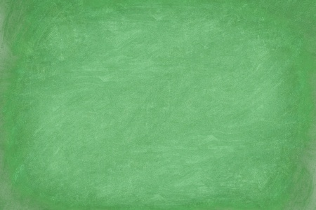Green chalkboard  blackboard texture background closeup. Well textured closeup texture of blank empty green blackboard. photo