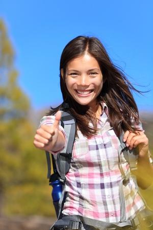 hike: Hiking girl happy thumbs up smiling.