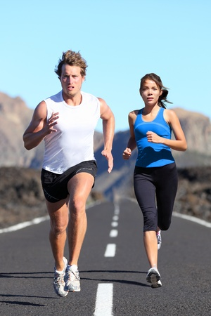 Runners outdoor jogging workout on road beautiful landscape.  photo