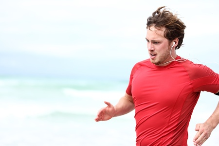 men exercising: Running man. Runner athlete in outdoor workout sprint. Young sport man training outdoors in beach.