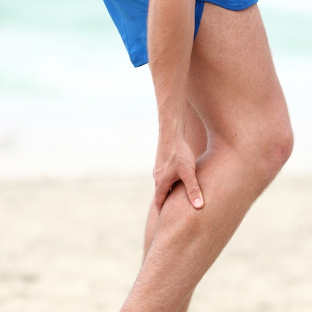 aching muscles: Leg calf sport muscle injury. Runner with muscle pain in leg. Stock Photo