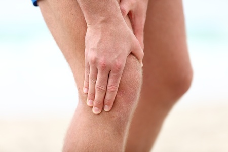 aching muscles: Knee Pain. Sports running knee injury in male runner.