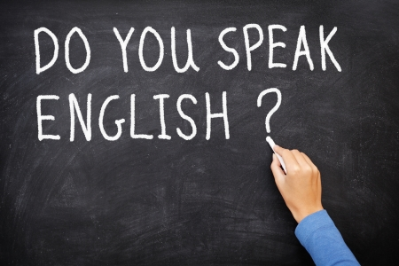 talk to the hand: Learning language - English. Blackboard education concept saying Do You Speak English? written on Chalkboard. Stock Photo
